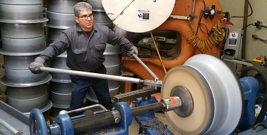 Owner Lou Estrada metal spinning a steel bellmouth