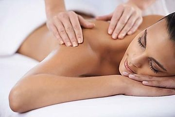 woman relaxing on massage table getting massage.