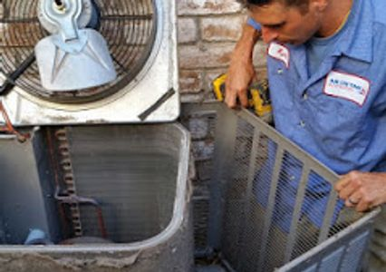 HVAC technician performing ac repair and maintenance on an air conditioner in Conroe, Texas.