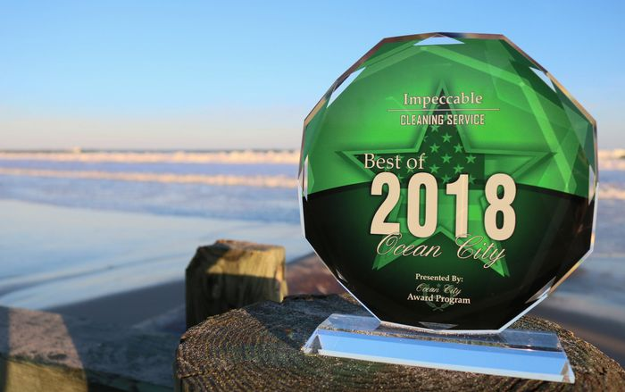 ocean city best cleaning service trophy at the beach