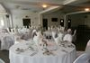 The Oysterfleet Hotel White Stretch Lycra Chair Covers with Vintage Cabbage Rose Print Taffeta Sashes
