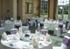 The Lawn Ivory Stretch Lycra Chair Covers with Purple Organza Sashes with Butterfly Pattern