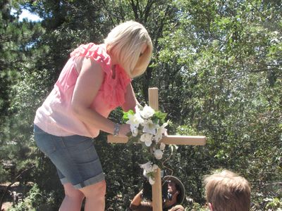 Mother erecting cross after her son died while at a drug rehab facility.