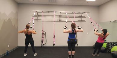 Suspension training that uses body weight exercises to develop strength, balance, flexiblity and cor