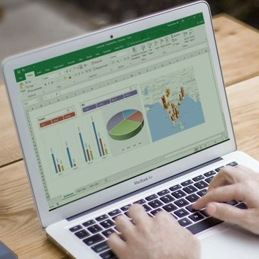 A user building a powerful dashboard in Microsoft Excel