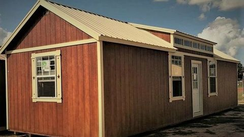 14x40 Chalet. Comes standard with a 7:12 roof pitch, 9 lite steel walk in door & 2 insulated windows