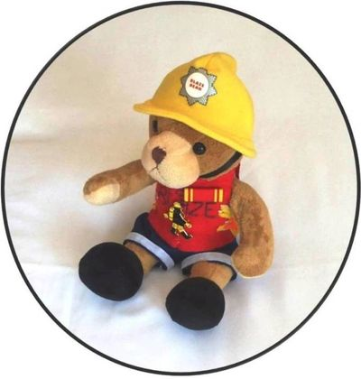 Team mate Blaze bear.  Teddy bear mascot in red cycling jersey  wearing 20 years long service medal.