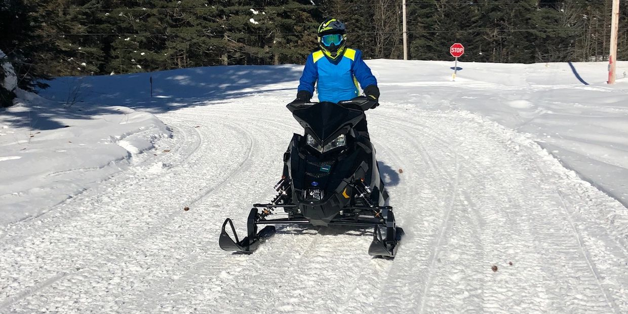 Snowmobile Guide riding  Snowmobile on snowmobile trail