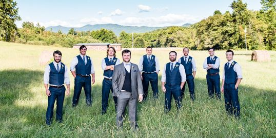 Groomsmen and Groom enjoy the natural rustic elements the mountains and farm have to offer.