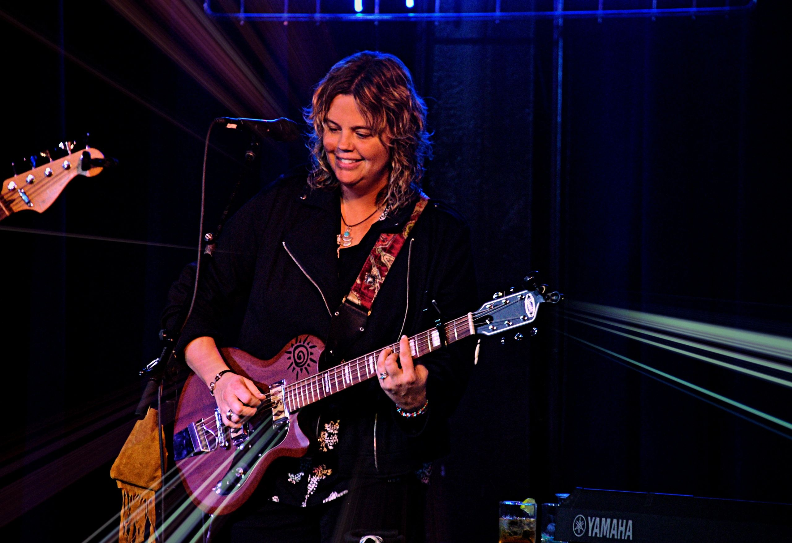 Kristine Jackson on stage at the with Supro Baritone Guitar