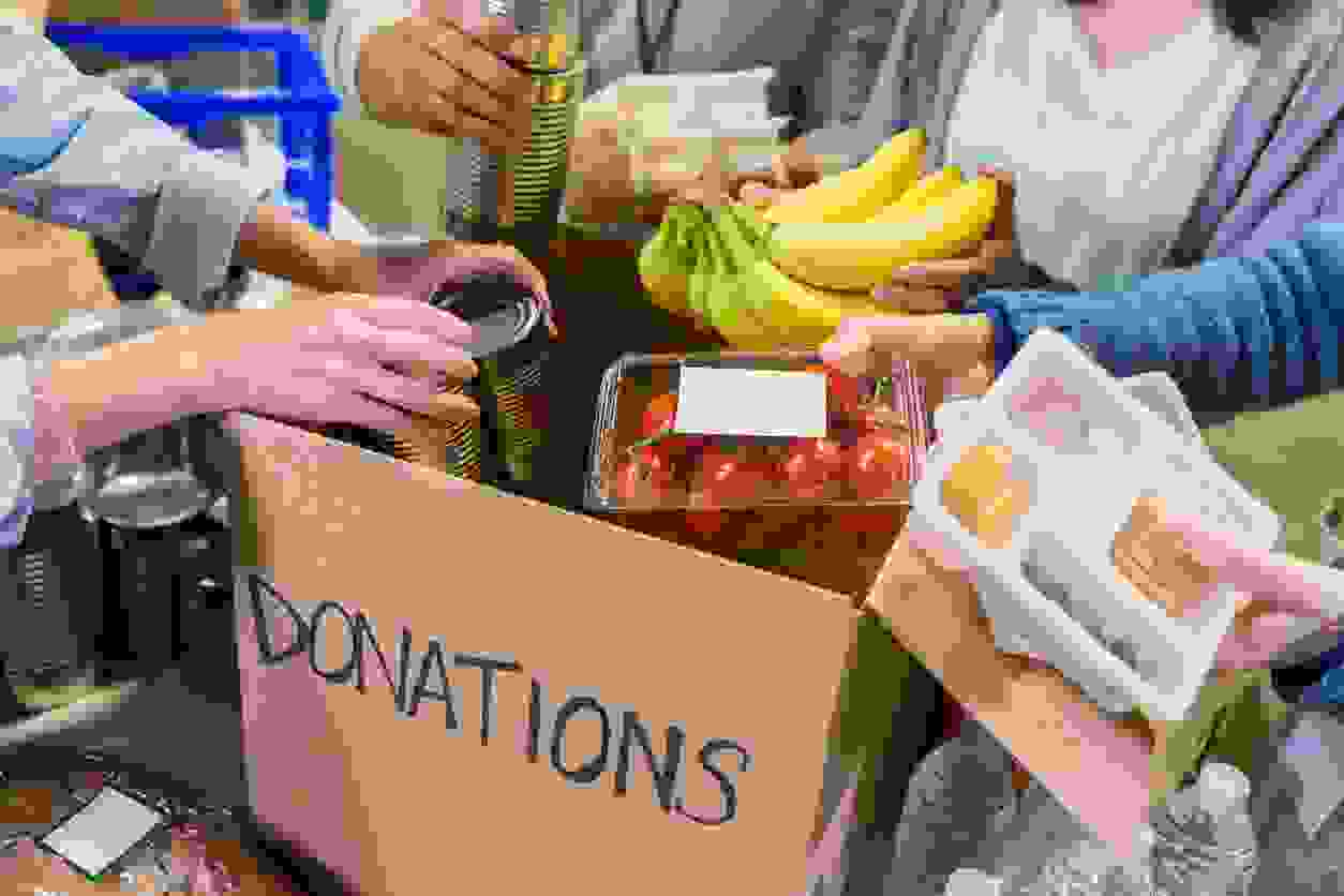 Portland Pay It Forward, the Portland TN Food Pantry, making boxes of food to give out to residents.