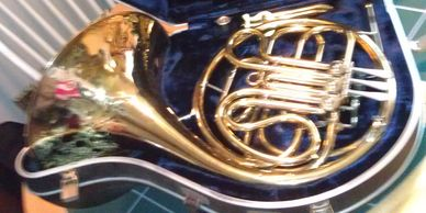 Blurry photo of a french horn