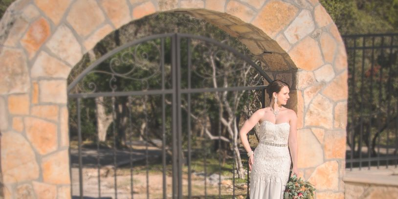Intimate wedding stone arch Messina Inn. Image by Brubaker Portraits