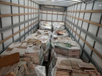 Truck load of pallets with boxes of paper that will be recycled into toilet paper.