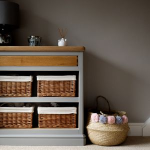 Hallway cabinet with oak box jointed drawer and wicker basket storage.
