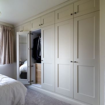 Wall to wall Shaker wardrobes with oak internal drawers. Fitted by TW Bespoke in Burton on Trent.