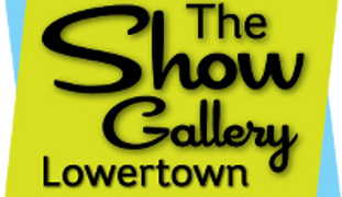 Graphic: yellow background black words reading, The show gallery lowertown
