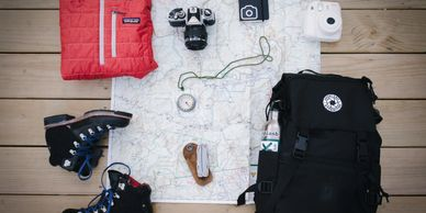 Hiking gear, map, backpack, and boots