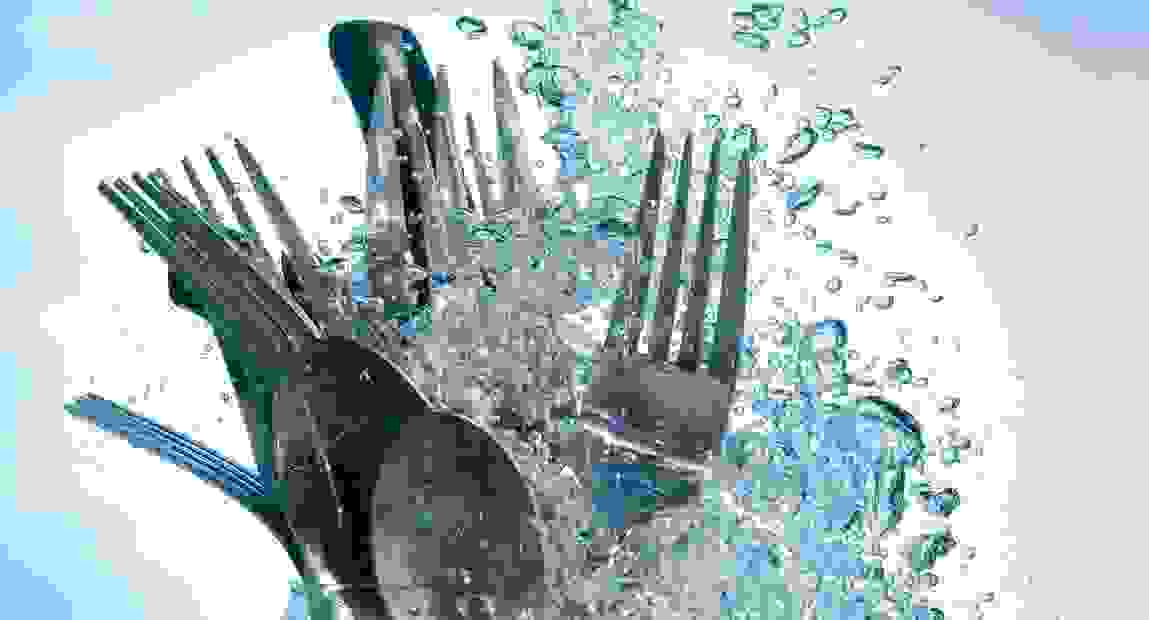 Spoons and forks in water.