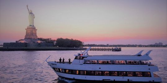 The Festiva at dusk on the Statue of Liberty Cruise.