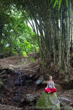 Leanne meditating on rock in Bali forest