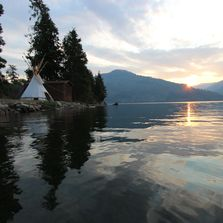 Hawkins Point sunrise seen from the private beach with a tipi at the ranch on Lake Pend Oreille