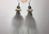 Wolf fur earrings with wolf  knuckles and cracked moon glass accents