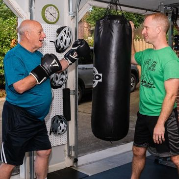Experienced trainer working with Parkinson's patient.