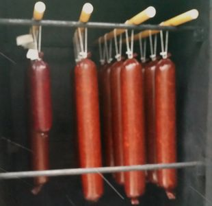 Salami and Summer Sausages hanging in the smoker.