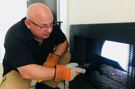 Home inspector checking a fireplace