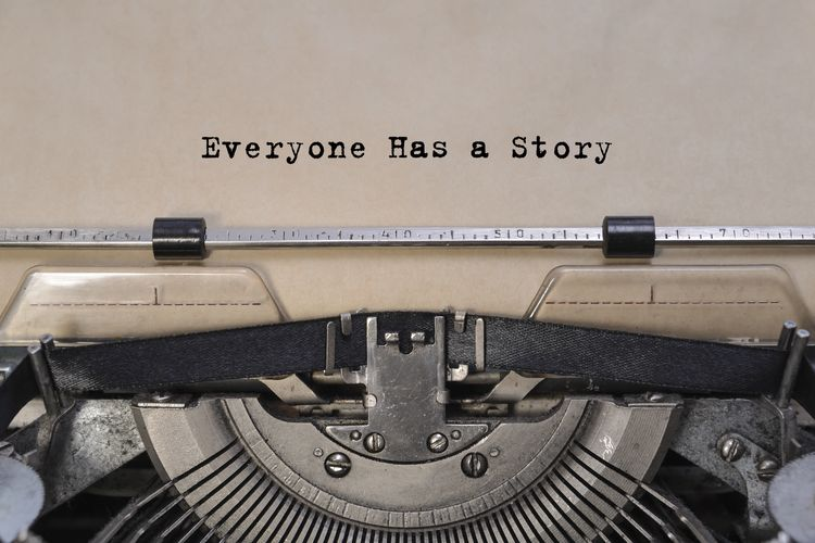 vintage typewriter that has typewritten words that say: 'Everyone has a story'