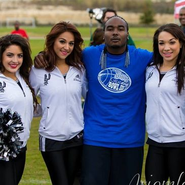 Thuggizzle with Silver Dancers at celebrity football game. Thuggizzle booking information on website