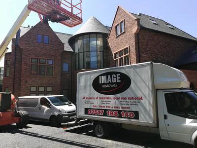 Large van removal outside a mansion house