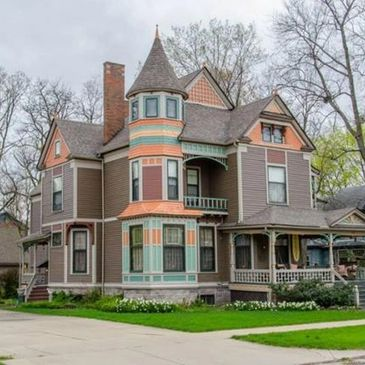Queen anne style historic home. Three floors with cone shaped turret on front corner. Front porch swing up porch stairs.