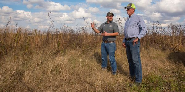 Quail Forever Biologist Wes Buchheit and landowner discussing quail and habitat