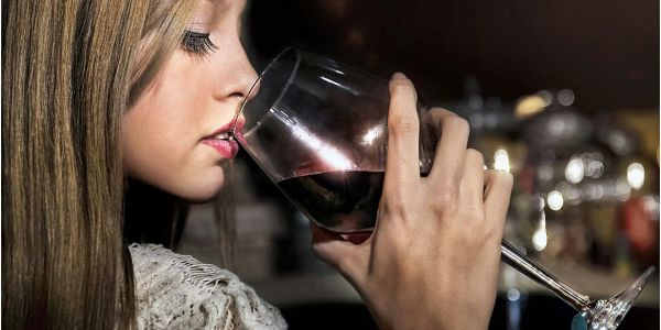 Beautiful young woman sipping Sultry Cellars red wine. Courtesy of Pixabay