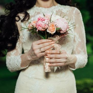 Bride wearing a wedding dress holding flowers