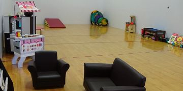 Children's playroom with a variety of activities and toys.