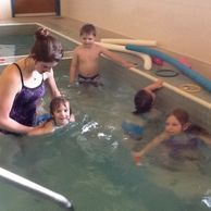 Children learning the basic principles of swimming.