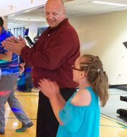 Fathers and Daughters enjoy music and dancing.