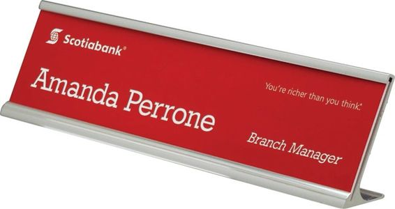 Angled metal desk nameplate bracket with red plastic nameplate