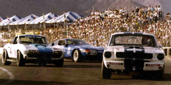 This shot at the Palm Springs Vintage races shows our Founder's Vette involved in a little schoolin'....