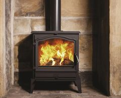Black esse 700 freestanding multi fuel wood heater with large viewing glass door.