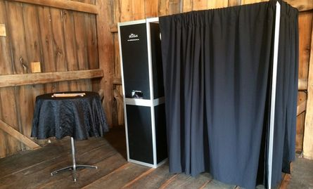 little black booth photo booth rental set up at party in Grand Rapids