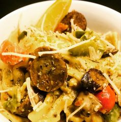 Delicious Farfalle pasta served with a cream mushroom sauce, Cajun seasoning and sauteed peppers
