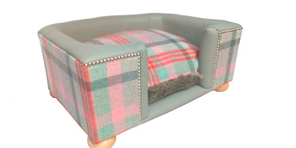 Luxury leather dog bed in pale grey leather with pink checked wool tweed.Wooden feet