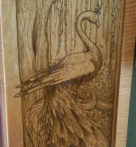 Laser engraved peacock.