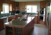 Kitchen island with prep sink, cook top and eat-in area for 2