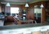 "Kitchen with double ovens, 48"" refrigerator/freezer, wine cooler, warming drawer, ice maker and breakfast area for 4"