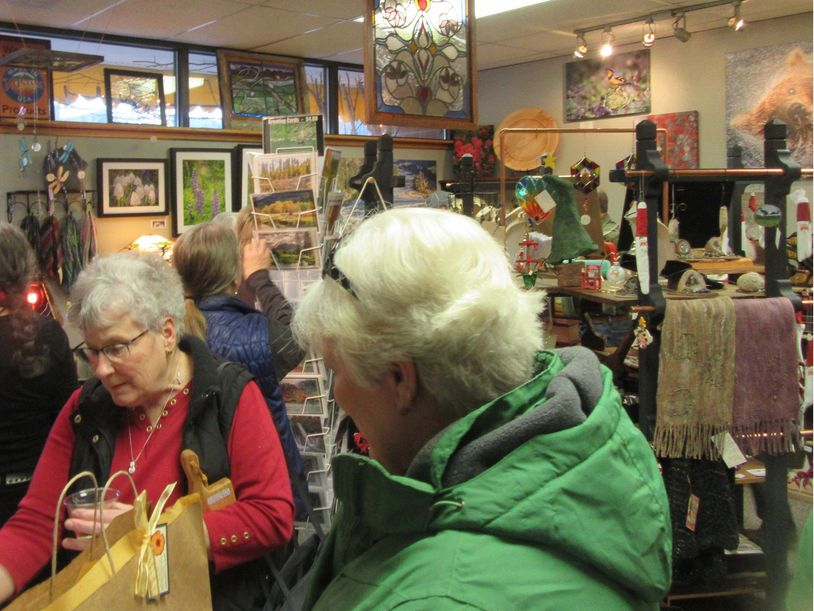 Shoppers enjoy food and wine while mingling with the artists at our annual Holiday Celebration.